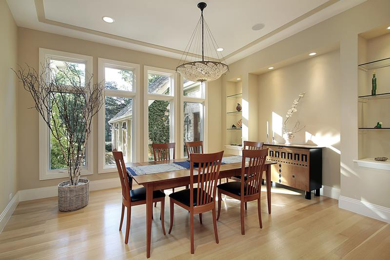 Dining room in luxury home with four narrow windows
