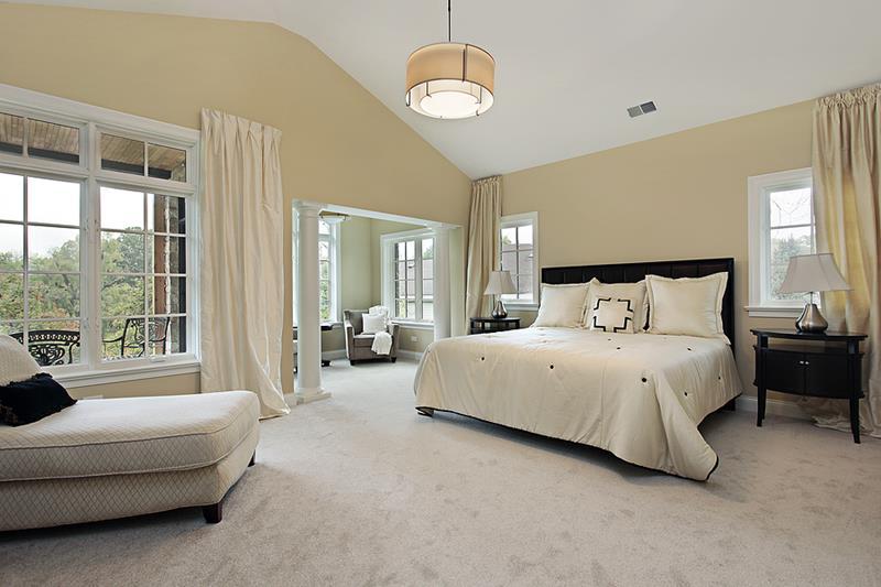 Master bedroom in luxury condominium with sitting room