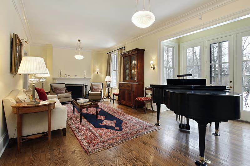 Living room in luxury home with large piano