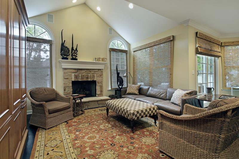 Family room in luxury home with stone fireplace