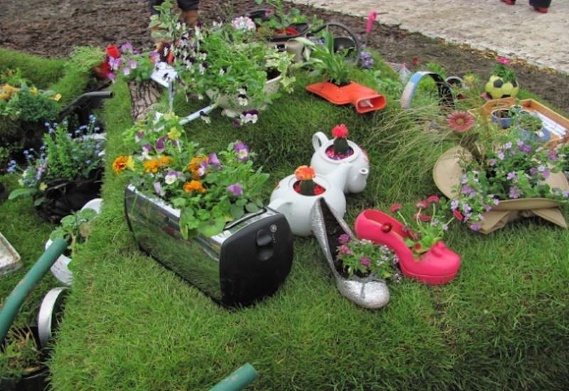 16 Amazing Ways to Enhance Your Garden with Recycled Items-title